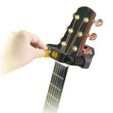 hercules stands wall mount wood guitar stand w free lock long mcquade musical instruments. Black Bedroom Furniture Sets. Home Design Ideas