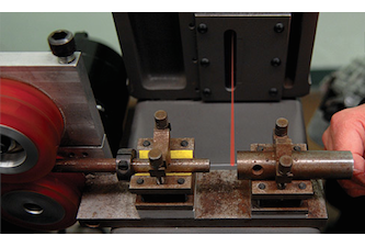 Laser guitar string manufacturing device